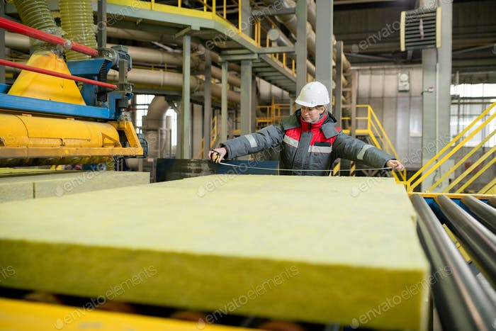 Measuring construction material at factory