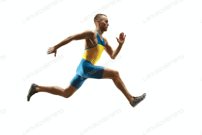 Young caucasian man running or jogging isolated on white studio background.