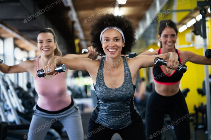 Picture of cheerful fit fitness team in gym
