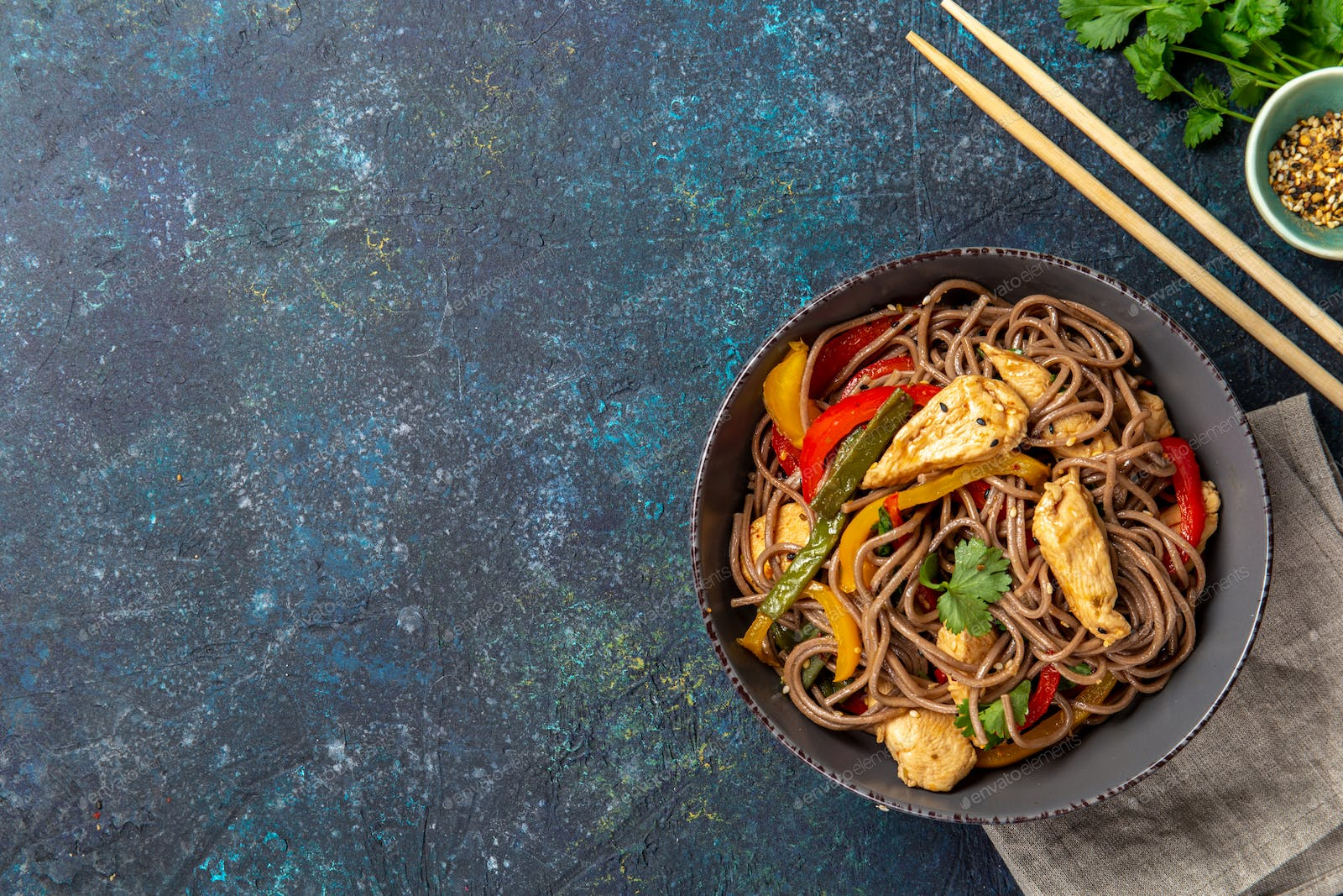 Japanese dish buckwheat soba noodles with chicken and vegetables carrot,  bell pepper and green beans photo by lblinova on Envato Elements