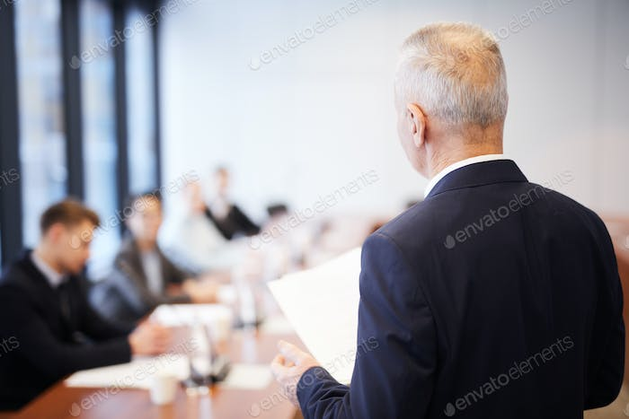 Mature Business Man in Meeting