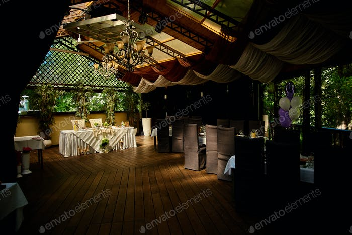 Wedding table in rustic style, decorations made of wood and wildflowers served