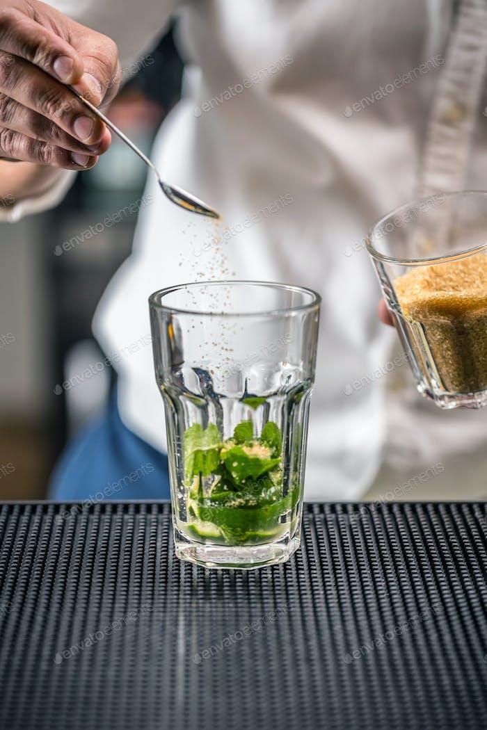 Preparing mojito cocktail