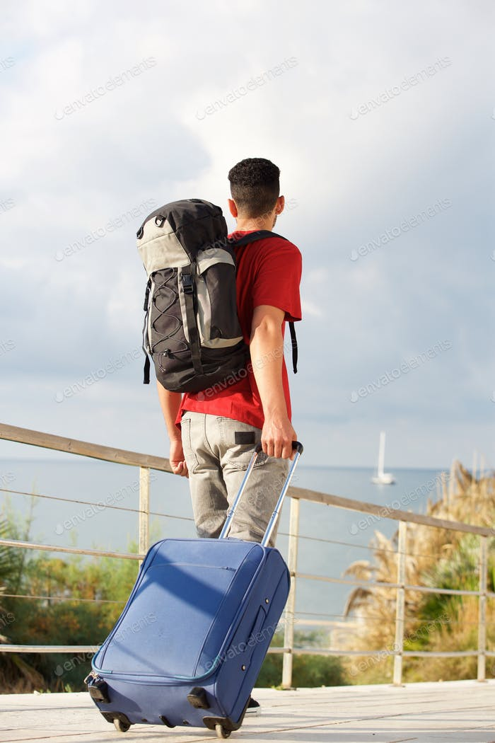 Full length backpacker walking away backpack and suitcase