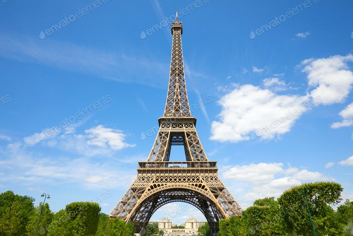 Eiffel Tower in Paris in a sunny summer day, blue sky in France