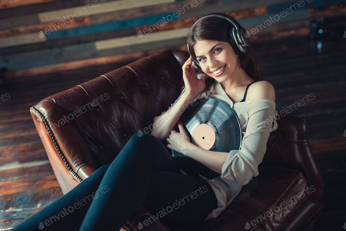 Smiling young girl listening to music