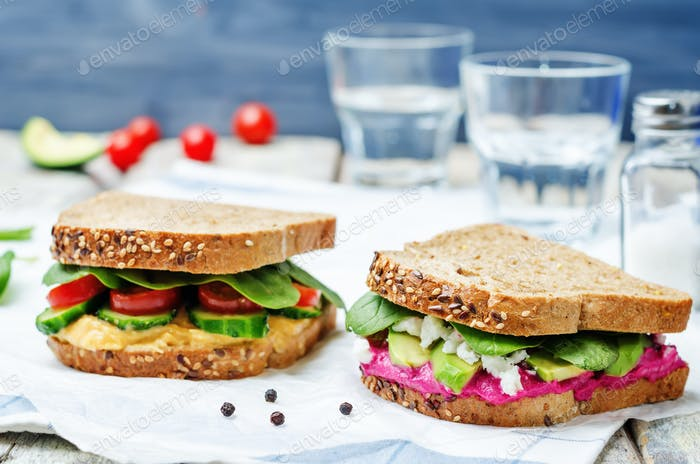 rye sandwiches with carrots and beetroot hummus and vegetables