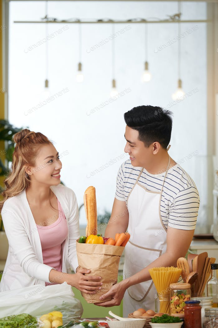 Cheerful couple in kitchen