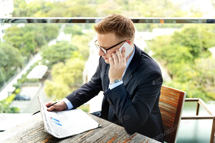 Businessman Reading Global Business Report Concept