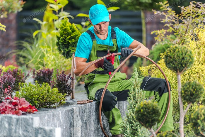 Men Building Garden Irrigation