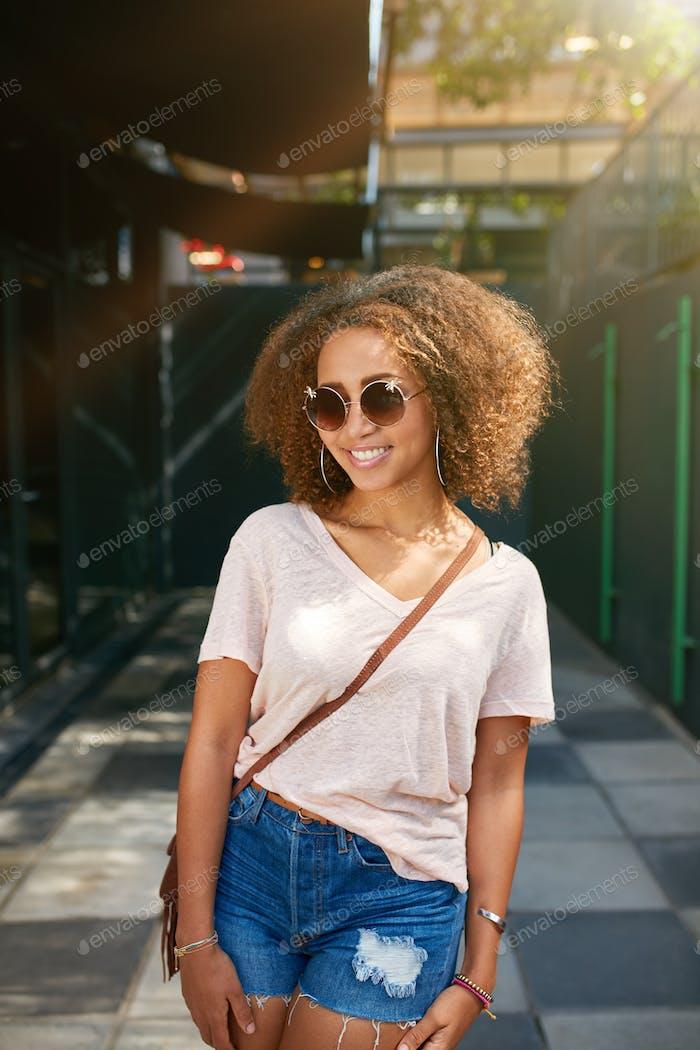 Beautiful young black woman smiling at camera