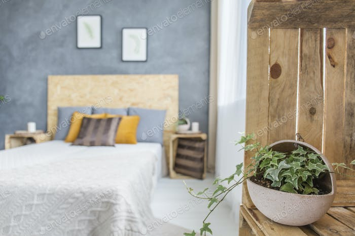 Bedroom with concrete wall