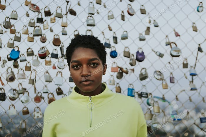 Woman by a fence with padlocks in LA