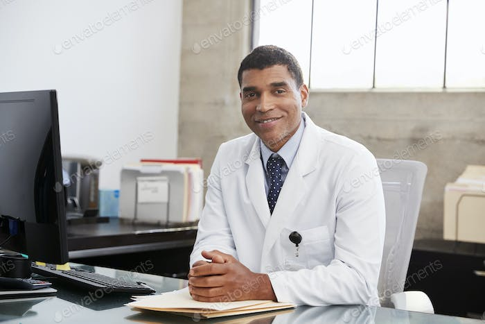 Mixed race  male doctor at desk, portrait