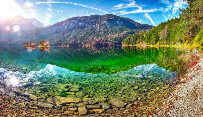 Faboulus autumn landscape of Eibsee Lake in front of Zugspitze summit at sunset