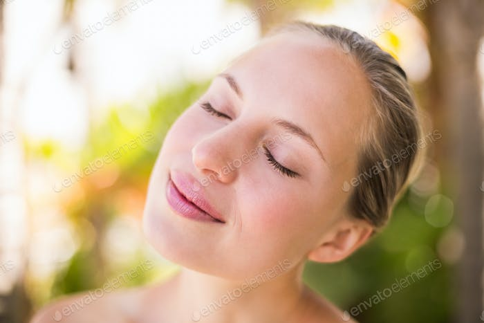 Beautiful young woman at spa center