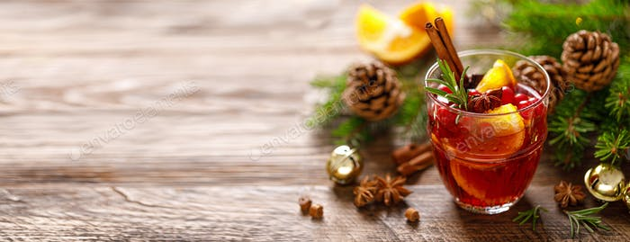 Christmas mulled wine. Traditional festive drink with decorations and fir tree. Banner
