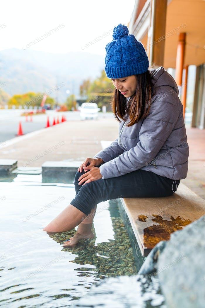 Woman having foot bathing onsen