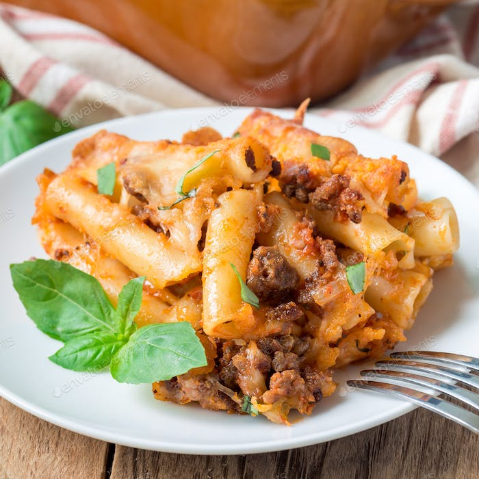 Ziti bolognese on a white plate, square format