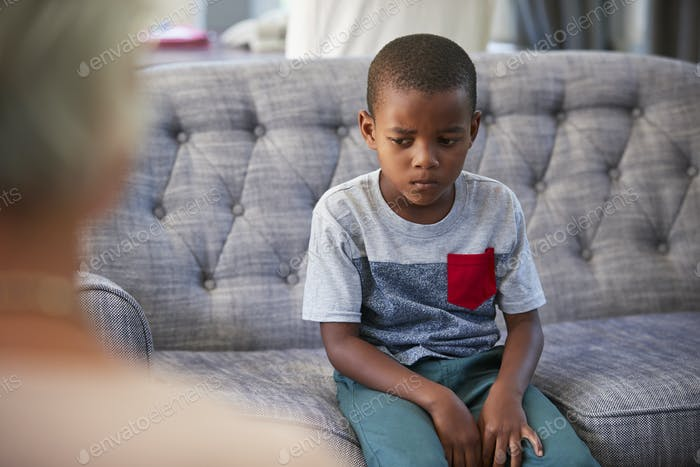 Young boy having therapy with a child psychologist