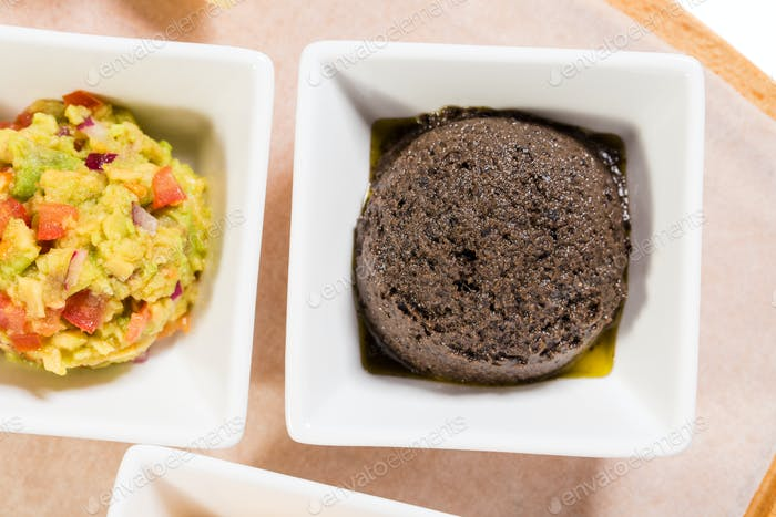 Tapenade of black olives as a appetizer.