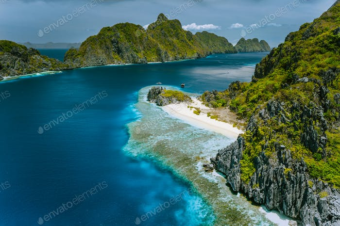 Limestone karst cliffs of Matinloc and Tapuitan Islands and straits between at Palawan, Philippines