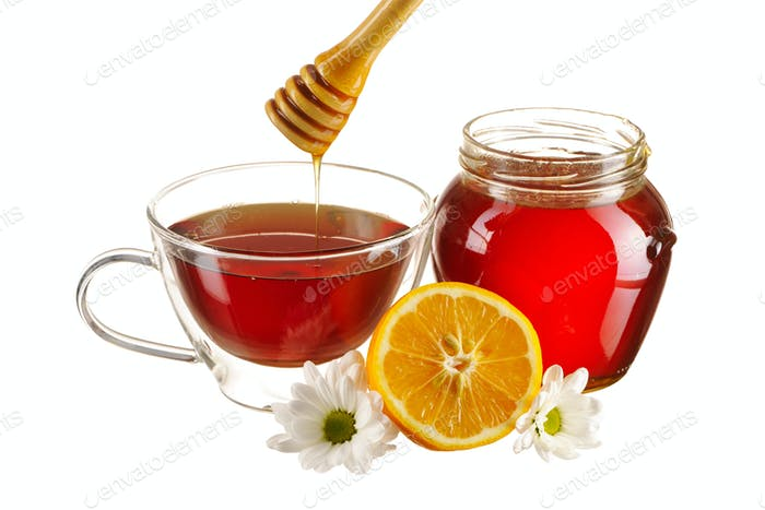 Jar of honey and tea cup