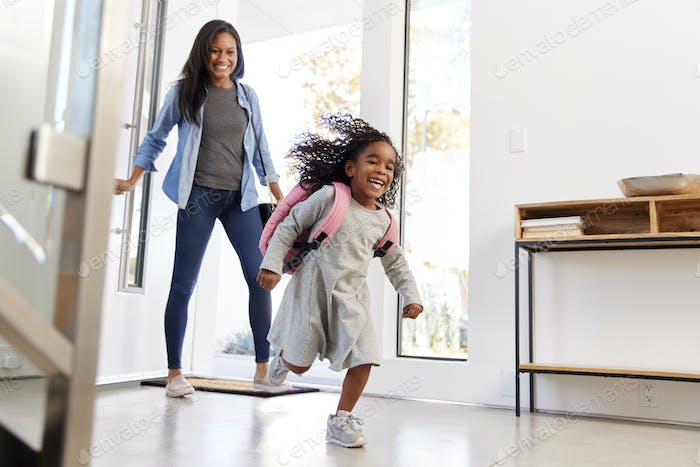 Mother Collecting And Bringing Daughter Home After School