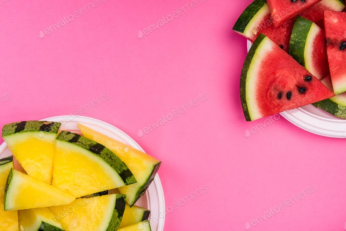 Red and Yellow Seedless Watermelon Sliced on Plates,Pastel Backg