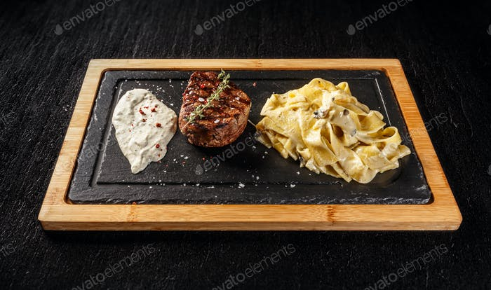 Tenderloin steak with pasta
