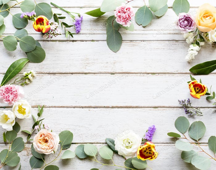 Various Fresh Flowers with Blank Design Space Wooden Background