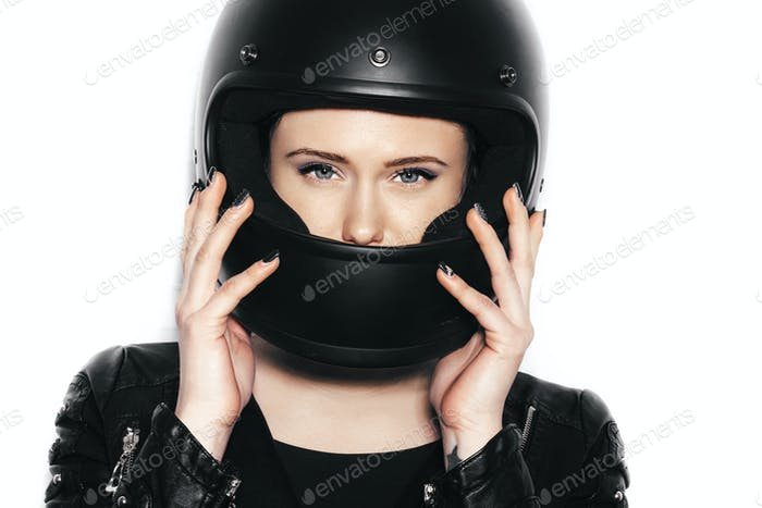 portrait of young beautiful woman in biker helmet