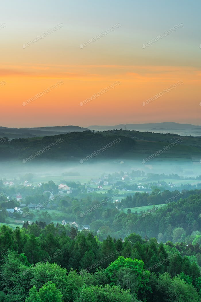 Spring fog over countryside at sunrise