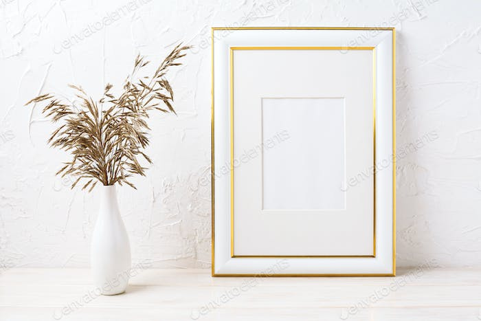 Gold decorated frame mockup with dried grass