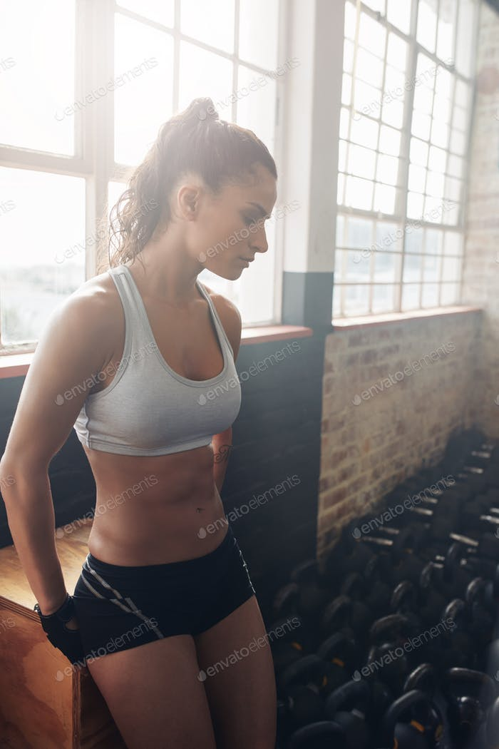 Attractive fitness woman taking a break