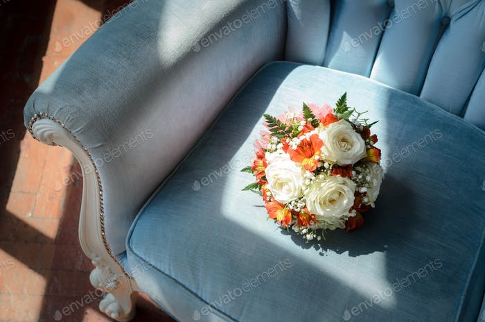 Bridal bouquet in soft antique chair