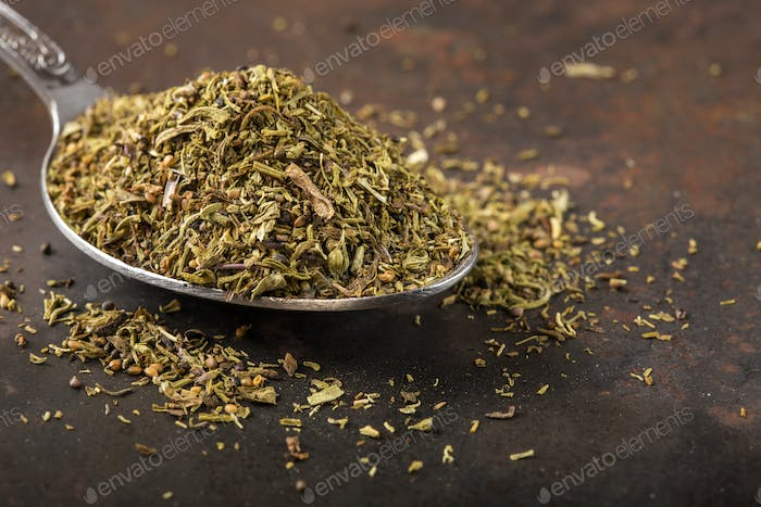 Spoon filled with dried thyme