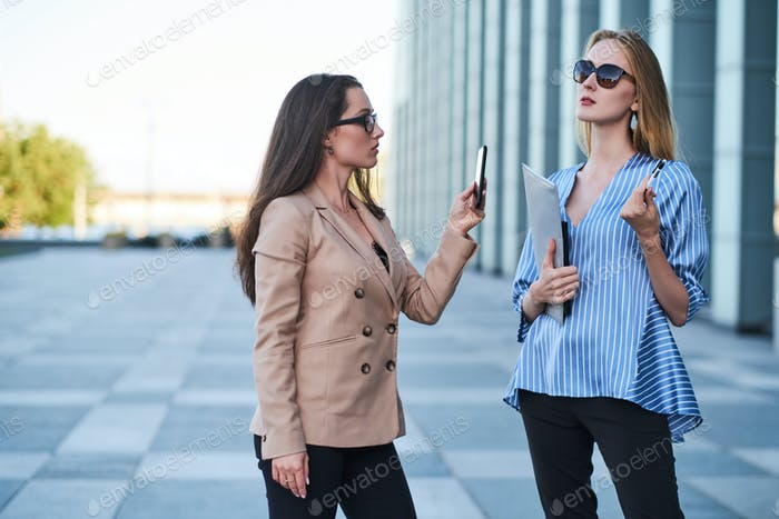 Portrait of two sucessful females in the city