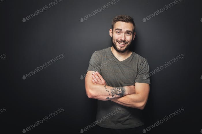 Joyful, handsome man on a black background