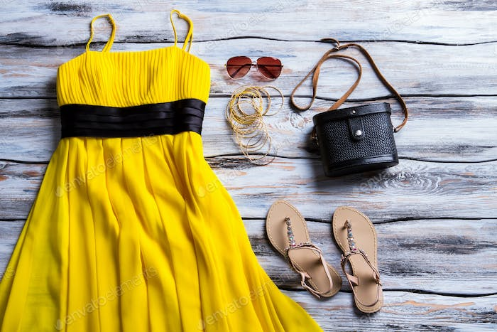 Yellow dress and beige sandals.