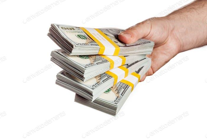 Hand holding bundles of 100 USD 2013 edition bills