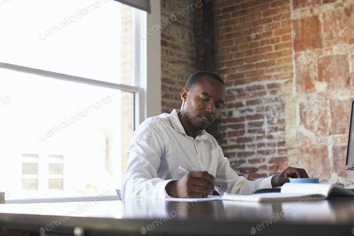 Businessman Working On Computer In Office