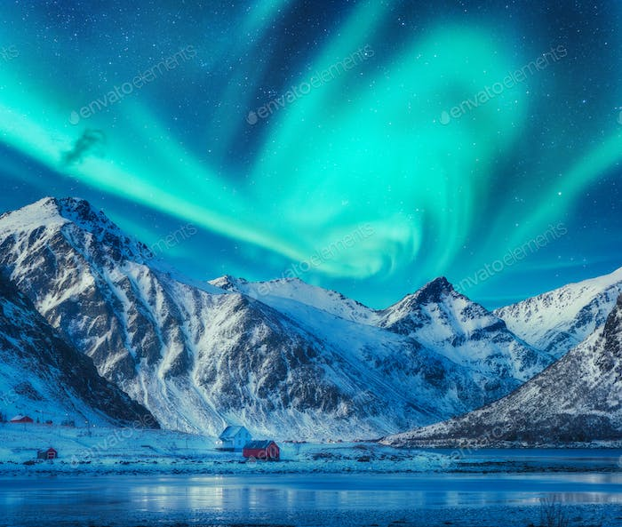 Northern lights above snowy mountains, frozen sea coast