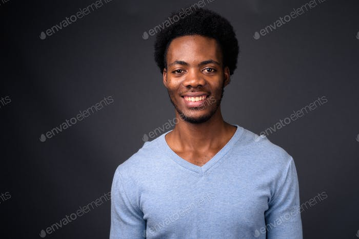 Thumbnail for Young handsome African man against gray background