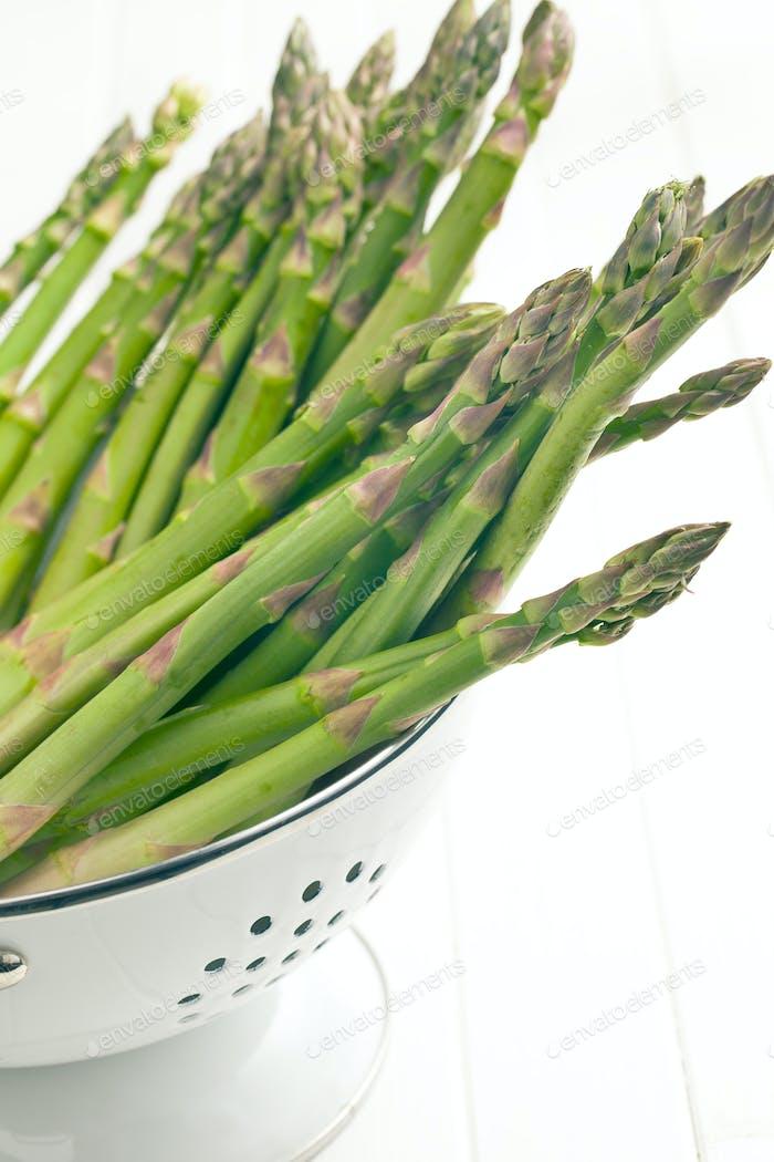 green asparagus in colander