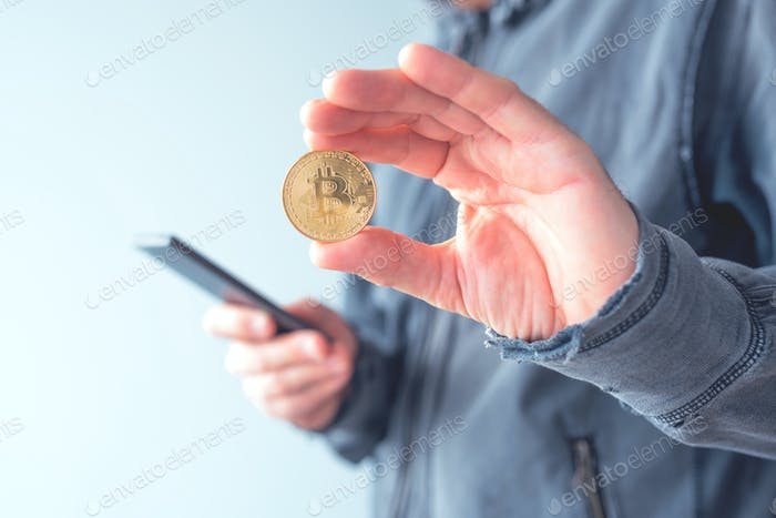Man with bitcoin and mobile phone