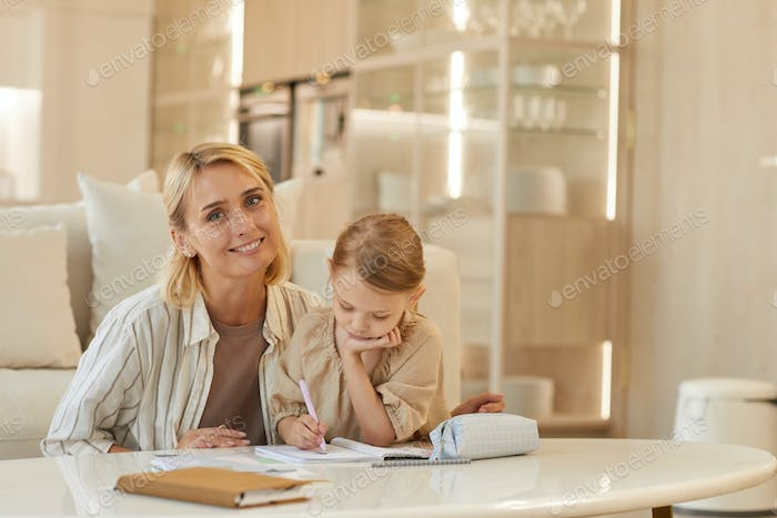 Mother Homeschooling Little Girl