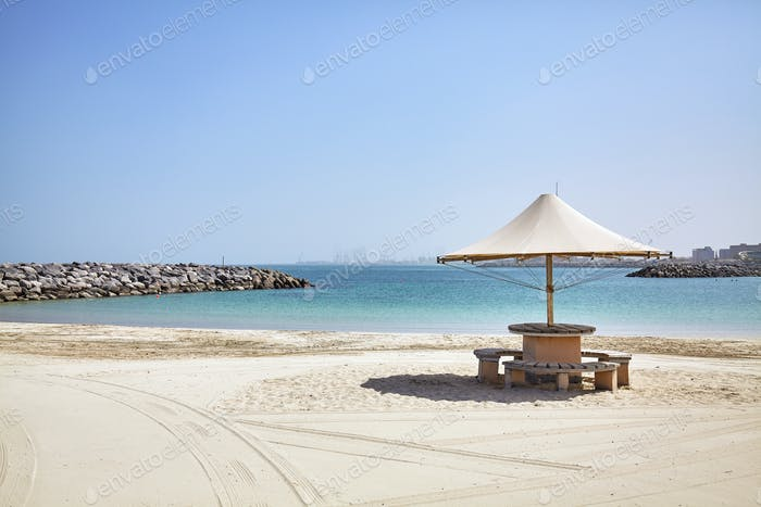 Sun umbrella on an empty beach