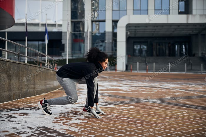 Woman is preparing for a sprint start