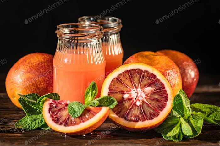 Jars of fresh blood orange juice, selective focus